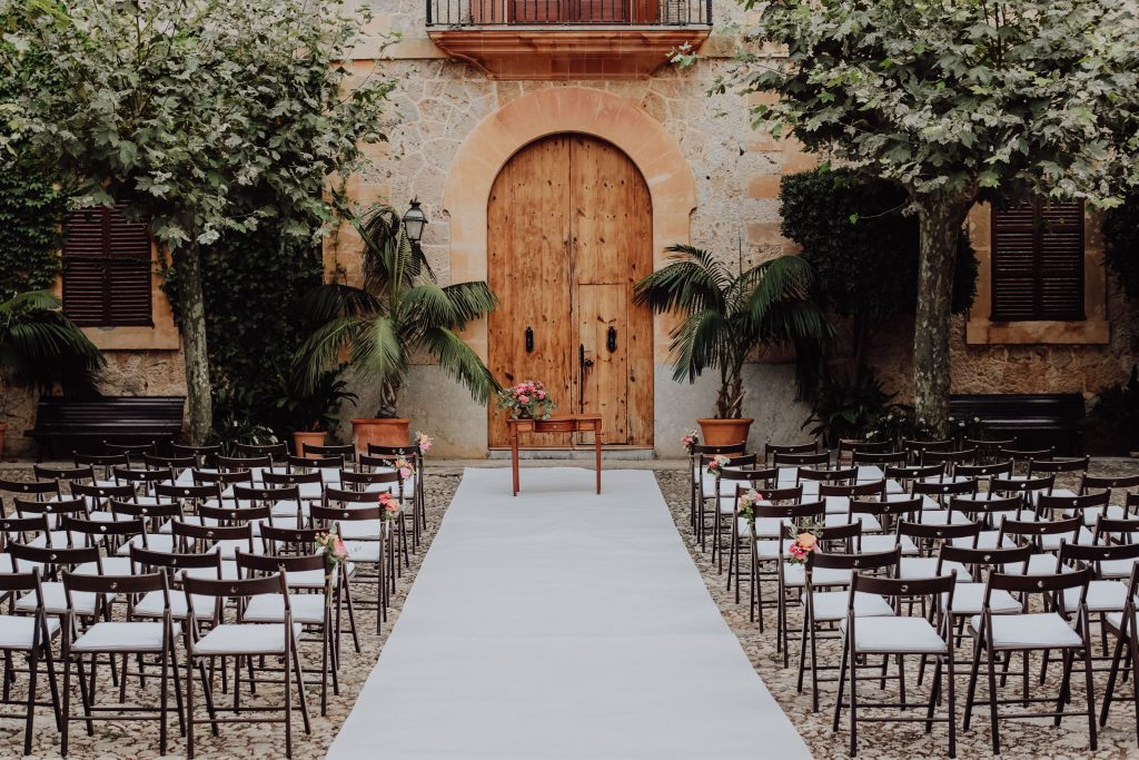 Photo of the wedding ceremony in front of the main building in Son Tugores